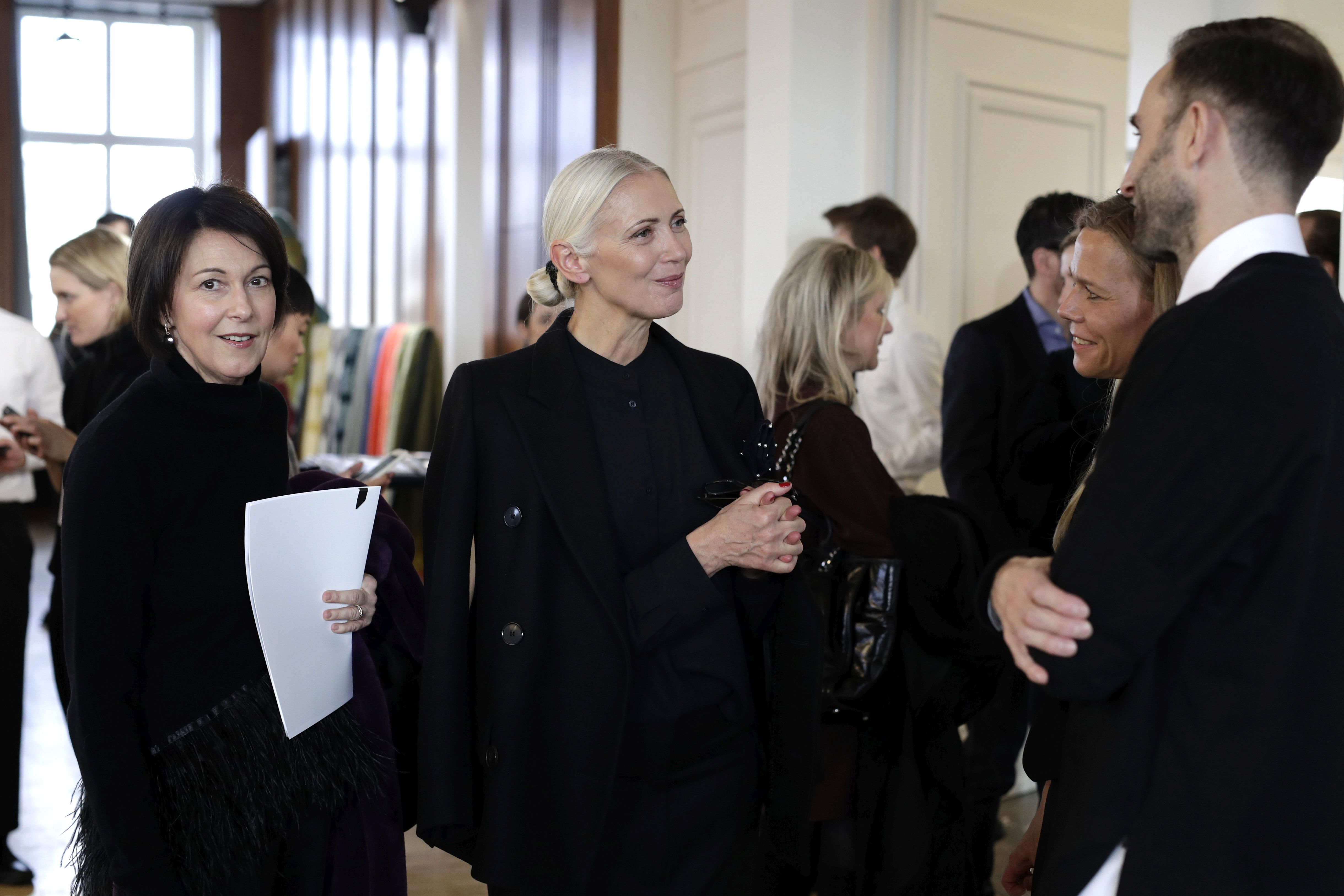 Christiane Arp chats with Antonia Goy and Bjoern Kubeja of Working Title during the Vogue Salon during 'Der Berliner Salon' AW 18/19 at Kronprinzenpalais on January 16, 2018 in Berlin, Germany.